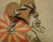 "New Old Stock Circa 1960s Puffy Heart Matte Silver Tone Heart Link Bracelet w/ Toggle Clasp, 7 3/4"", Korea"