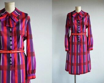 Vintage 60s Dress / 1960s Mod Red and Purple Plaid Print Wool Secretary Shirt Dress with Belt Peter Pan Collar Bow / Leonard Arkin