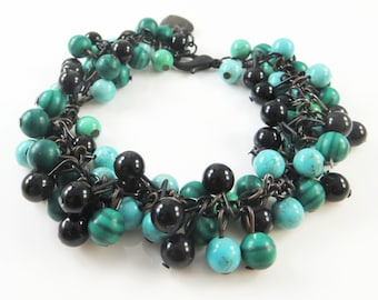 Green and black cha cha bracelet