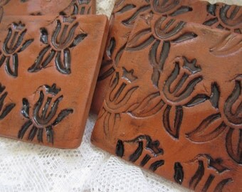 Four Black and Terra Cotta Square Coasters with Flower Design