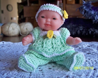 Baby Dolls in Crocheted Green Pajamas, Yellow Jumper, Purple Dress or Blue Baseball Uniform with Various Head Coverings