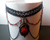 Black lace goth, victorian choker with red flower cameo pendant and black chains.