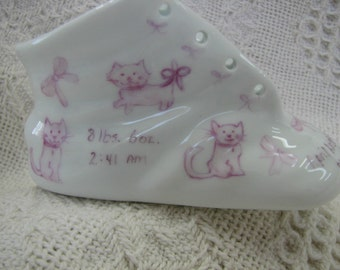 Kittens hand painted on a baby shoe/baby bootie