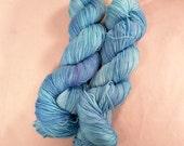 Bibbidi Blue on Lolo 75/25 SW Merino Nylon Hand dyed fingering weight sock yarn