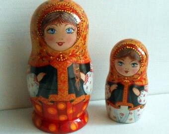 Nesting dolls (matryoshka) in Russian style Khokhloma in handmade.