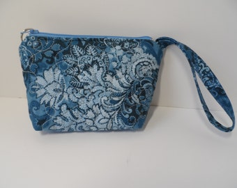 Quilted wristlet in navy grey paisley cotton use as an i phone tote