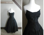 Mistress of the Dark 1950s Beaumelle Black Strapless Drop Waist Taffeta Dress with Winged Bodice/Tulle Detail
