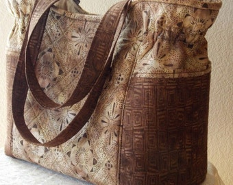 Handmade large quilted tote purse handbag in batik browns, beige, scrolls, diagonals, basket weave, floral, medallions, pin dots, flowers