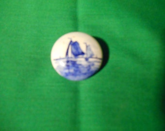 "One (1). Signed,  1 3/16""  Blue Delft Brooch."