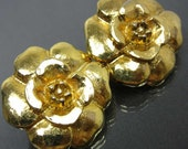 Vintage CHANEL extra large golden camellia, rose flower clip on earrings. Classic Chanel jewelry for your collection. So chic and mod.