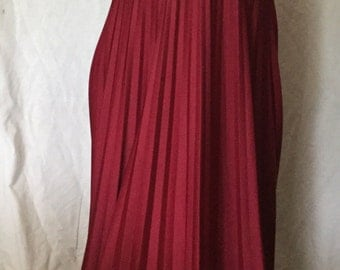 1970's burgundy floor length gown with accordian bottom