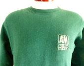 vintage 80's 90's A&M Studios solid dark forest green reverse weave graphic sweatshirt crew neck embroider chest logo pullover jumper medium