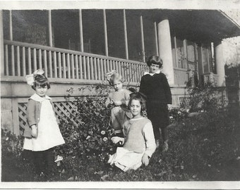 Old photo Girls and Boy outside by House Hair Bows 1910s Photograph snapshot vintage Children Kids