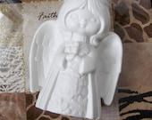 white ceramic angel candel holder 1980's 6 inches x 4 1/2 inches