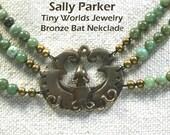 Bronze Good Luck Bat Necklace with Green Gemstones