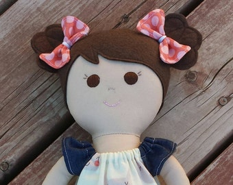 Handmade fabric doll with dark brown hair and brown eyes
