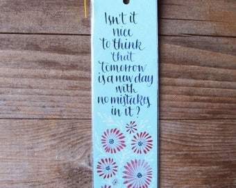 """Anne of green gables light blue bookmark with quote in handwritten calligraphy. """"Isn't it nice to think..."""""""