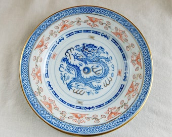 Two vintage Chinese rice grain dessert plates…small dragon plates…bread plates…rice grain plates…red accents…gold trim.