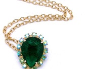 Vintage Necklace With A Large Green Glass Stone Trimmed in AB Rhinestones