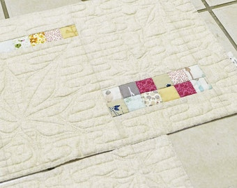 A set of four placemats. Japanese style fabric placemats, neutral fabric placemats, quilted placemats