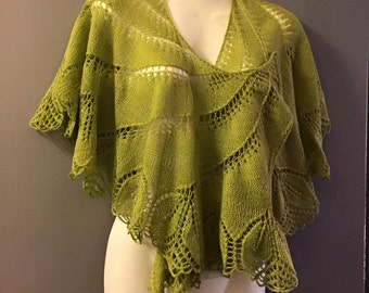 Green shawl knitted by hand