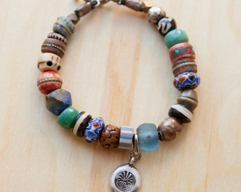 Exotic Beaded Bracelet with Signature 1111 Tapuat Charm