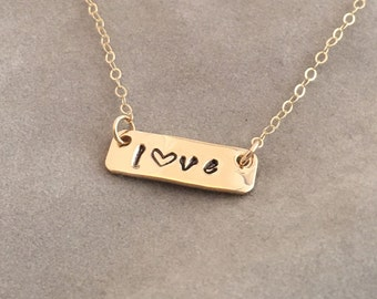 Handcrafted stamped love bar necklace
