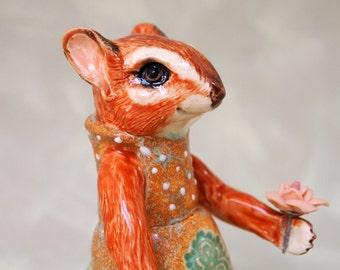 cute ceramic chipmunk figurine in party dress with flower