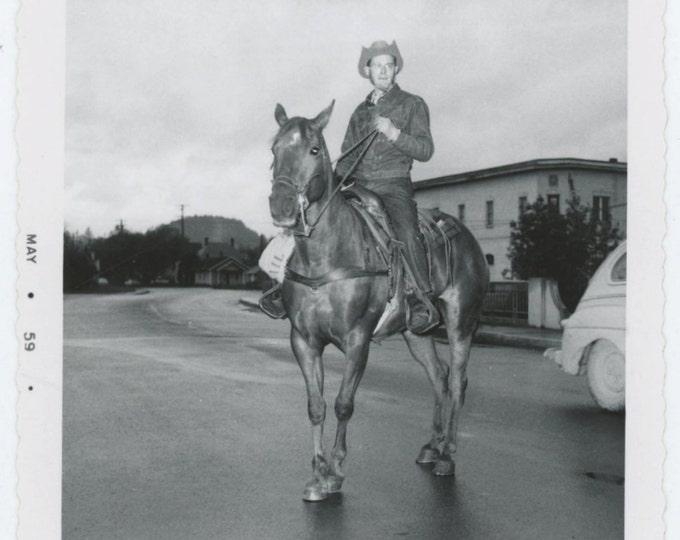 Man on Horse in Street, 1959  Vintage Snapshot Photo (65466)