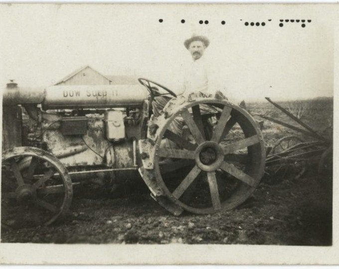 """Farmer on Tractor, """"Dow Sold It"""" 1930s Vintage Snapshot Photo (512436)"""