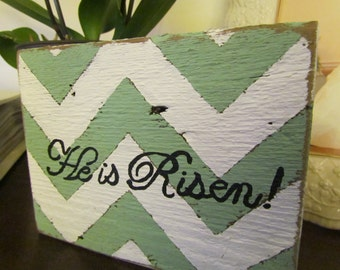 """Small Barn Wood Plaque Painted a Chevron Design in a Distressed White and Seagreen with the Words """"He is Risen"""""""
