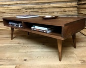 Boxer mid century modern coffee table with storage, featuring black walnut & tapered wood legs.