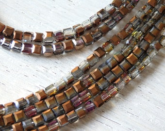 Copper sparklers - long strand of 4mm sparkling copper and grey crystals with olive and pink highlights, 4mm faceted cube AB crystal beads