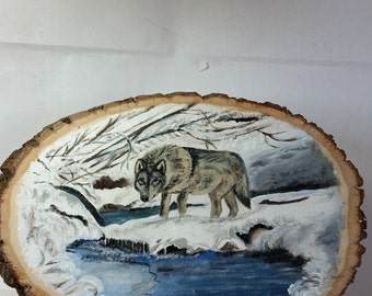 Winter Wolf at stream