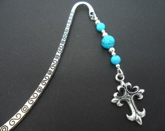 A tibetan silver and turquoise bead cross  charm  bookmark.