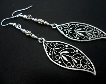 A pair of pretty tibetan silver leaf long dangly earrings.