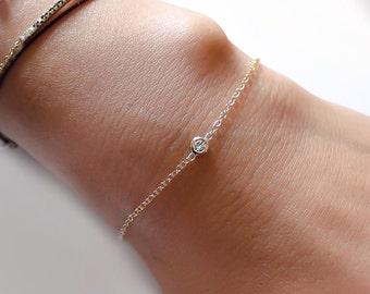 Delicate solitaire diamond bracelet