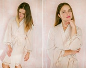 Soie Champagne. 4 knee length robes in faux crepe de chine silk trimmed with lace. Bridal robes and bridesmaids robes in neutral tones.