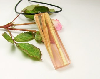 Medium size wood resin fusion pendant.Semi translucent pink resin on bamboo. All natural UVpoxy.