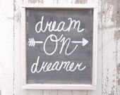 Gray and white dream on dreamer rustic wood sign with arrow
