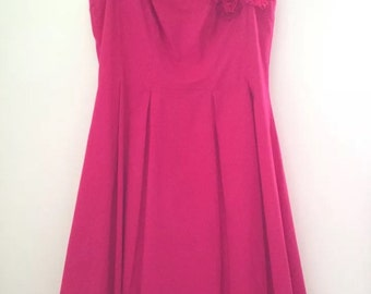 Vintage hot pink party dress with flowers on the shoulder