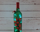 Wine bottle lamp with hand painted strawberries