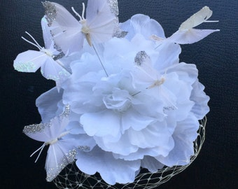White flower and butterfly fascinator with white netting