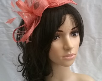 Salmon Feather Fascinator Rosette & loops with crystal stamens on a headband Wedding races