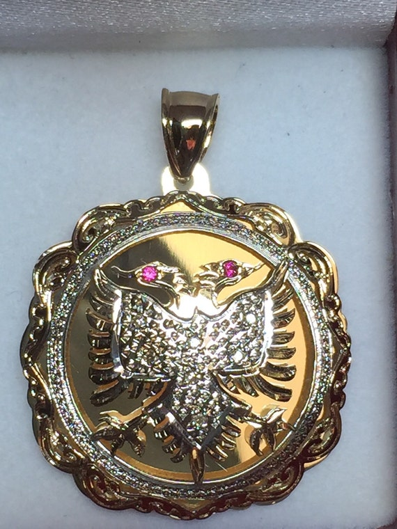 albanian eagle national pendant 0 10crt in diamonds in 14k
