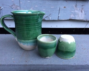 Green pitcher with cups