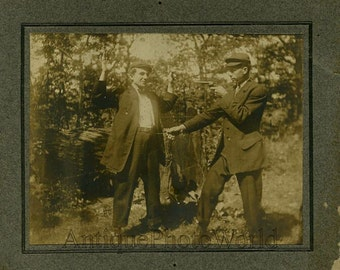Mock gun fight antique comic photo