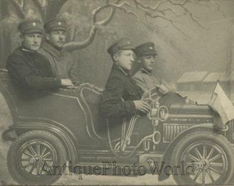 Soldiers in fake automobile car antique studio arcade photo