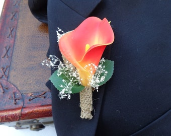 Real touch orange calla lily boutonniere trimmed with burlap