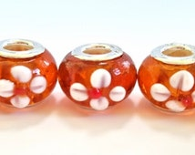 Orange with White Flowers Glass Beads for European Bracelets.  Pretty Design. 15 X 8mm.  Sold Individually.  5 Orders Available.